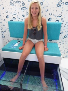 Brooke enjoying a fish-nibbling foot spa treatment.